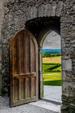 Open Heavy Door With View To Irish Landscape Royalty Free Stock Photography