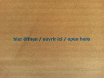 Open here - corrugated cardboard Royalty Free Stock Images