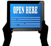 OPEN HERE on tablet screen, held by two hands. Royalty Free Stock Photos