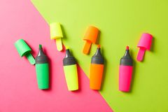 Open highlighters on two tone background. Space for text royalty free stock photos