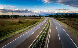 Open highway through pastoral landscape Royalty Free Stock Image
