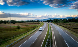 Open highway through pastoral landscape Royalty Free Stock Images