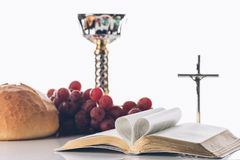 Open holy bible with christian cross, and chalice on table,. Holy Communion royalty free stock photo