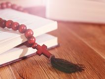 Open holy bible with wooden cross in the middle. Christian concept Royalty Free Stock Photos