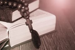 Open holy bible with wooden cross in the middle. Christian concept Royalty Free Stock Image