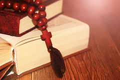Open holy bible with wooden cross in the middle. Christian concept Stock Image