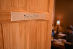 Open Hospital Door to a MEDICINE Room,Healthcare and people conc Royalty Free Stock Image