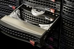 Open hot swap HDD. Open Hard Disk Drive in black hot swap frame. Nice reflection on platter royalty free stock photo