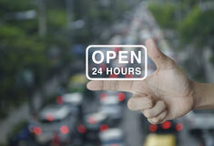 Open 24 hours icon on finger, e-business concept Royalty Free Stock Image