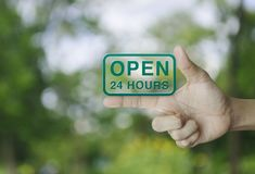 Open 24 hours icon on finger stock images