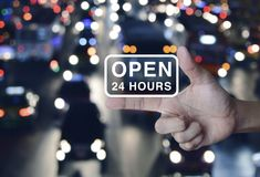 Open 24 hours icon on finger royalty free stock image
