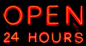 Open 24 Hours Neon Sign. On black background royalty free stock images