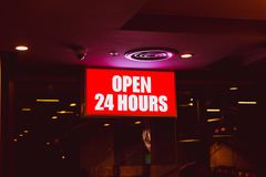 Open 24 hours sign banner in shop. Open 24 hours sign banner in fast food shop royalty free stock photo