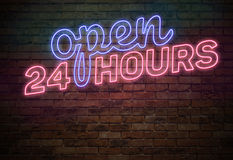 Open 24 Hours Sign on the Brick Wall. Blue and Red Neon Light Open 24 Hours Sign on the Brick Wall Royalty Free Stock Photography