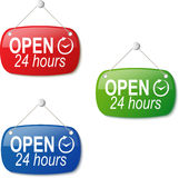 Open 24 hours signs in red green and blue on white Royalty Free Stock Photos