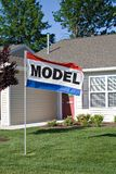 Open House. A large sign advertises model homes available for rent or sale in suburbs Royalty Free Stock Photo