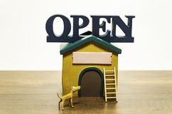 Open House With Yellow Dog And Ladder In Front Stock Photography