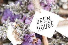 Open house word on card and purple flower background.  royalty free stock images