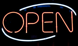Open illuminated sign on cafe. Illuminated neon sign for Open. Used on stores, restaurants, bars etc Royalty Free Stock Images
