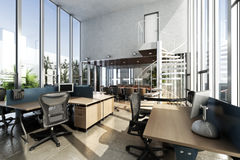 Open interior furnished modern office with large ceilings and windows Stock Photo