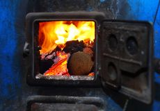 Boiler. Open iron stove in boiler room royalty free stock photo