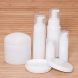 Open jar of cream and other body care cosmetics Stock Photography