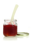 Open jar of mixed fruit jam Stock Photos