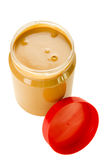 Open jar of peanut butter Stock Images