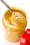 Open jar of peanut butter with spoon Stock Photo