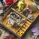 Open jewelry box. Above view of open jewelry box sitting on top of dresser Royalty Free Stock Image