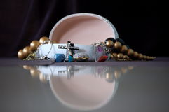 An Open Jewelry Box. With the jewels spilling out and the reflection of the box in front royalty free stock photography