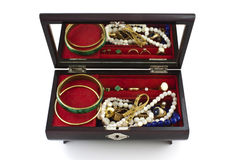Open jewelry box with jewels. Over white background Stock Images