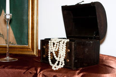 Open jewlery box. A black open jewlery box with white necklace royalty free stock photography