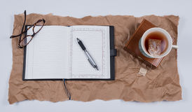 Open Journal Book and Cup of Herbal Tea stock image