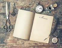 Open journal book and vintage writing tools. Memories. Retro sty Stock Photography