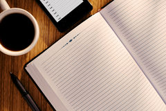 Open journal or diary with a mug of coffee Royalty Free Stock Image