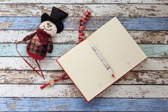 Open Journal, pen, and snowman. From top view stock images