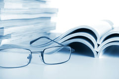 Open journals with glasses Stock Image