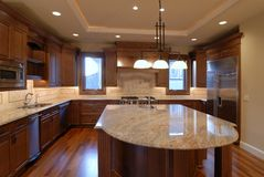 Open Kitchen. Large Kitchen of a New large American house Stock Photography