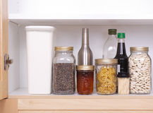 Open kitchen cupboard Royalty Free Stock Photos