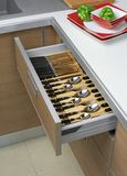 Open kitchen drawers Stock Photo