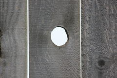 Open Knot Hole Wooden Fence. Stock Photos
