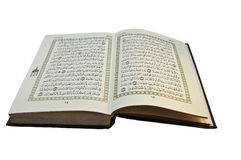 Open Koran with arabic writing visible. With a white background Stock Photo