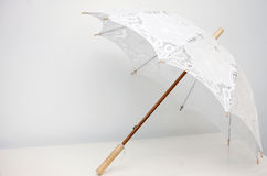 Open lace umbrella. Lace umbrella wedding accessory on white background stock photography