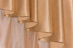 Open lambrequin (portiere, curtain) golden color Stock Photography