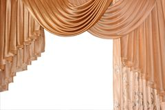 Open lambrequin (portiere, curtain) golden color on the window. Classic interior decoration indoor openings lambrequins back into fashion Royalty Free Stock Photos