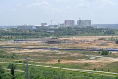 Open land after complete with ground leveling works. KUALA LUMPUR, MALAYSIA -DECEMBER 12, 2013: Open land after complete with ground leveling works royalty free stock images