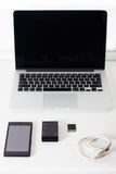 Open laptop with  black smartphone Royalty Free Stock Photography