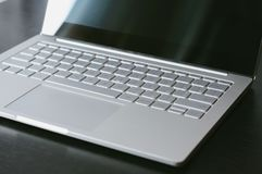 Open laptop with blank screen close-up. On the table Royalty Free Stock Photography