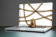 Open laptop with chain and lock Royalty Free Stock Photo